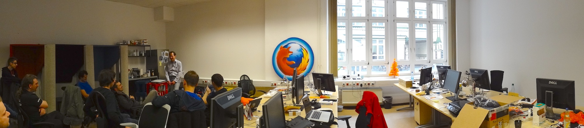 Panorama picture in the Mozilla Berlin Office. Attendees sit on chairs discussing ideas.
